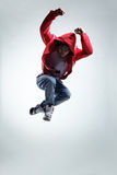 The dancer. Modern style dancer posing on studio background Stock Photo