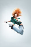 The dancer. Modern style dancer posing on studio background Royalty Free Stock Photo