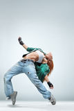 The dancer. Modern style dancer posing on studio background Royalty Free Stock Photos