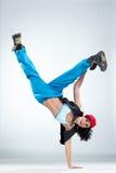 The dancer. Modern style dancer posing on studio background stock photography