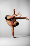 The dancer. Young male dancer posing over grey background stock images