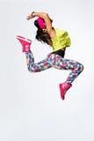The dancer. Modern style dancer posing on studio background stock photos