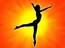 Dancer. Woman silhouette dancing in the sun light Royalty Free Stock Images