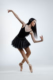 The dancer. Young beautiful dancer posing on a studio background Royalty Free Stock Photo
