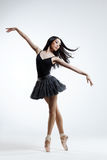 The dancer. Young beautiful dancer posing on a studio background stock photo