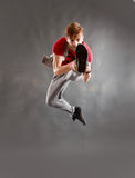 The dancer. The acrobatic dancer jumping high with his leg in front stock photos