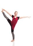 The Dancer. Attractive preteen dressed in dance warm up clothes dancing.   on white Royalty Free Stock Image