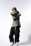 The dancer. Hip-hop style dancer posing on a white background Royalty Free Stock Photography