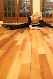 Dancer #40. A Female Dancer practicing in her studio - in a split, on the floor - Copy Space stock photography