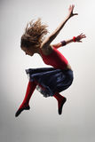 The dancer. Modern ballet dancer dancing on the grey studio background Stock Photography