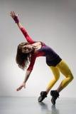 The dancer. Modern ballet dancer dancing on the grey studio background stock photo