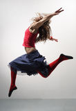 The dancer. Modern ballet dancer dancing on the grey studio background Royalty Free Stock Photo