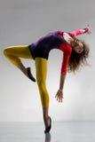 The dancer. Modern ballet dancer dancing on the grey studio background royalty free stock photos