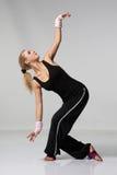 The dancer. Yaoung beautiful woman dancing on grey background stock photos