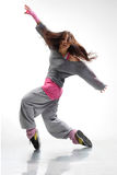 The dancer. Beautiful young hip-hop dancer posing on white background stock photography