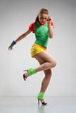 Dancer. Cool looking and stylishly dressed dancer posing Royalty Free Stock Image