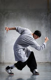 Dancer. Cool looking and stylishly dressed dancer posing stock image