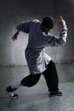 Dancer. Cool looking and stylishly dressed dancer posing royalty free stock photos