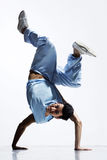 The dancer. Cool breakdance style dancer posing in freeze position royalty free stock photos