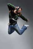 The dancer. Cool looking dancer makes a difficult jump stock photography