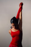 Dancer. Artistic portrait of young hispanic dancer woman in red clothes stock photo