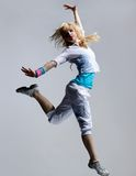 Dancer. Hip-hop dancer posing on grey  background Royalty Free Stock Photos