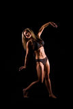 Dancer. A young woman working out on a plain backdrop Stock Photo