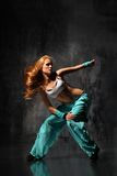 The dancer. Modern style dancer posing behind studio background Royalty Free Stock Photography