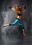 The dancer. Modern style dancer posing behind studio background stock photography