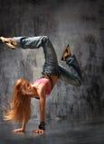 The dancer. Modern style dancer posing behind studio background Stock Image