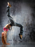 The dancer. Modern style dancer posing behind studio background royalty free stock images