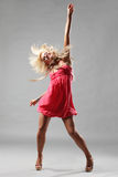 The dancer. Modern style dancer posing on studio background stock image