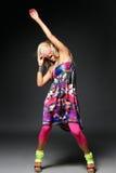 The dancer. Modern style dancer posing on studio background royalty free stock image