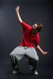 Dancer against dark background Stock Photos