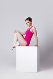 Dancer. attractive young woman gymnast on a white Stock Photography