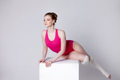 Dancer. attractive young woman gymnast on a white Royalty Free Stock Images
