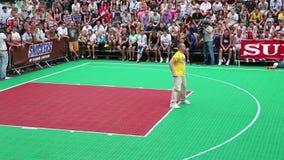 Dancer on basketball pitch. KIEV, UKRAINE, AUGUST 24, 2012: Dancer in yellow shirt. Final Ukrainian streetball league on Khreschatyk street dedicated to stock video footage