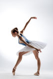 The dancer. Beautiful ballet dancer posing on a studio background stock photography