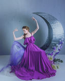 Dancer in a beautiful dress. Cute girl dancer in a beautiful dress posing in the studio. Tinted photos royalty free stock photo