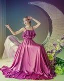 Dancer in a beautiful dress. Cute girl dancer in a beautiful dress posing in the studio. Tinted photos stock image
