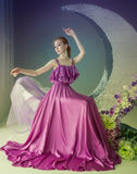 Dancer in a beautiful dress. Cute girl dancer in a beautiful dress posing in the studio. Tinted photos stock photography