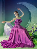 Dancer in a beautiful dress. Cute girl dancer in a beautiful dress posing in the studio. Tinted photos royalty free stock images