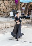 Dancer in a black authentic dress dances to the music for visitors at the annual festival `Jerusalem Knights`. Jerusalem, Israel, September 29, 2018 : Dancer in royalty free stock image