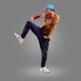 Dancer in a blue cap Stock Photos
