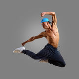 Dancer in a blue cap jumps Royalty Free Stock Photos