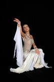 Dancer in blue-white dress Stock Photos