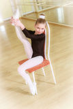 Dancer on a chair with dancing school Royalty Free Stock Photography