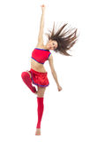 Dancer from cheerleading team dancing and jumping. Happy cheerleader dancer from cheerleading team dancing and jumping in red blue uniform colors against white Stock Photo