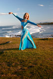 Dancer on cliff stock photography