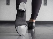 Toe Tap in Tap shoes with a back view stock image